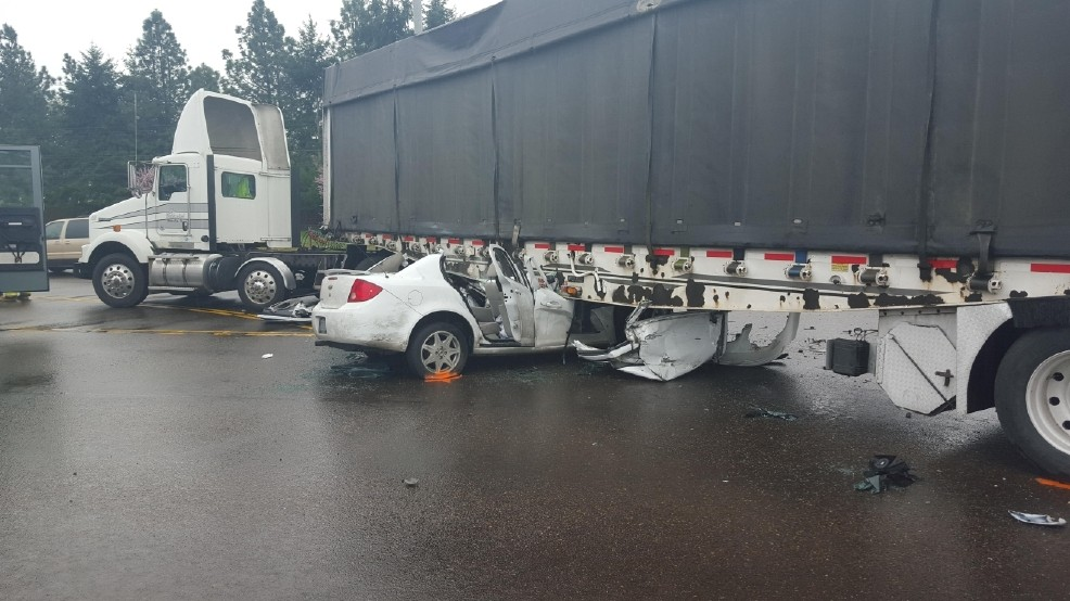 Car and semi truck crash